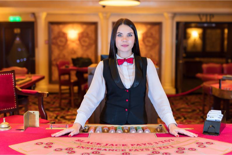 Female live blackjack dealer
