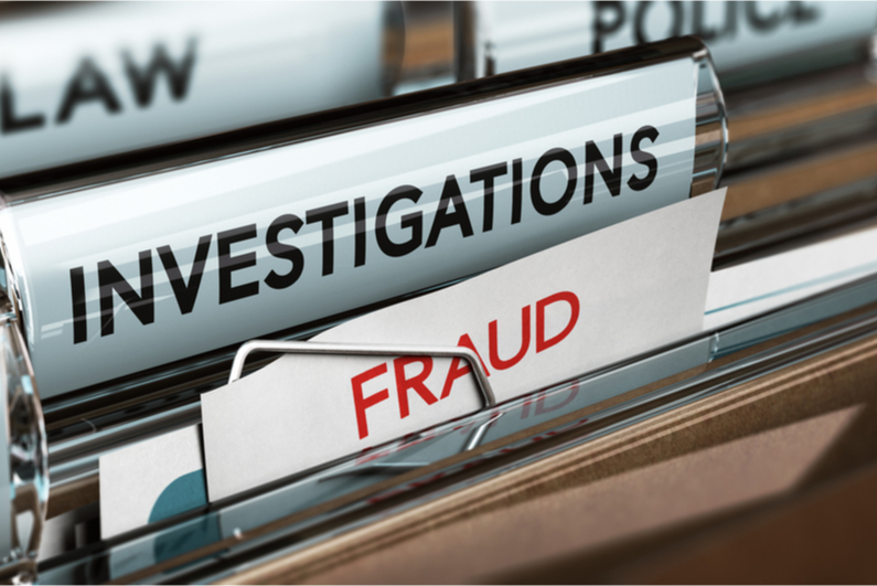 "File folders labeled ""FRAUD"" and ""INVESTIGATIONS"""