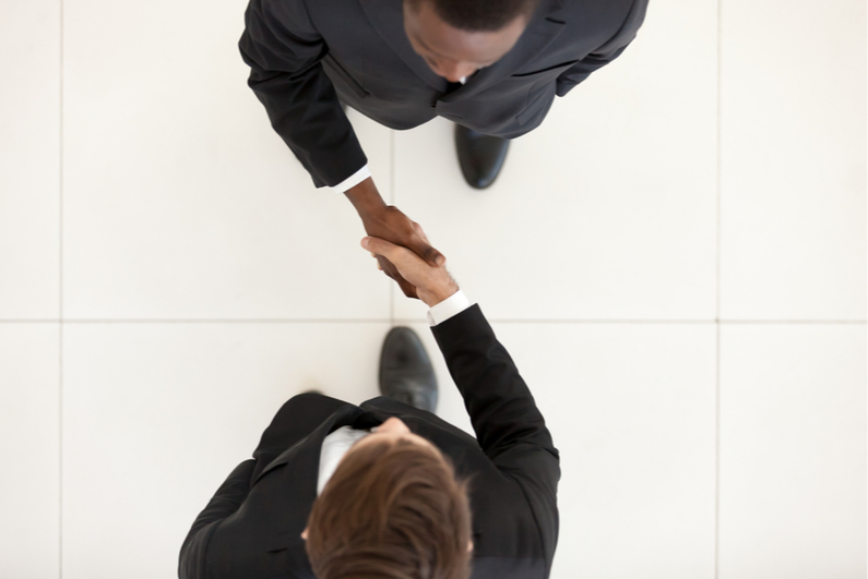 Overhead shot of two businessmen shaking hands