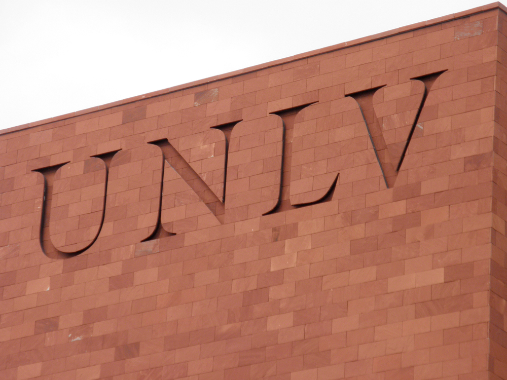 Letters UNLV inscribed on red brick building
