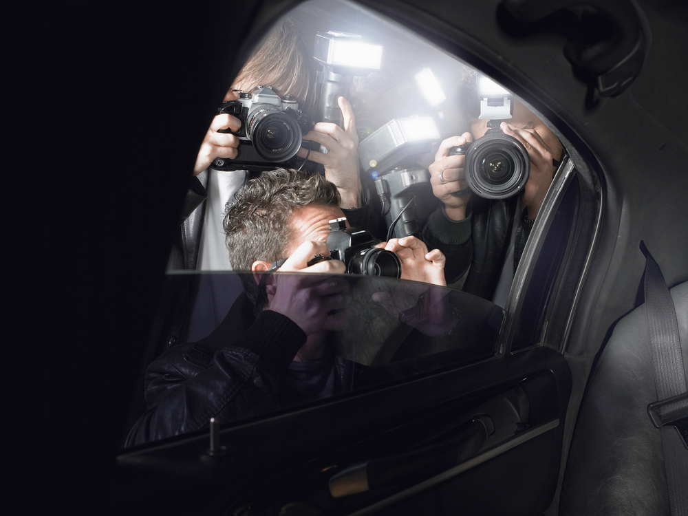 paparazzistanding outside car window take celebrity shots with their cameras