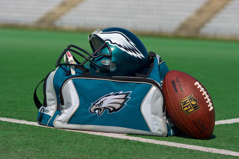 Philadelphia Eagles sports gear and football on pitch
