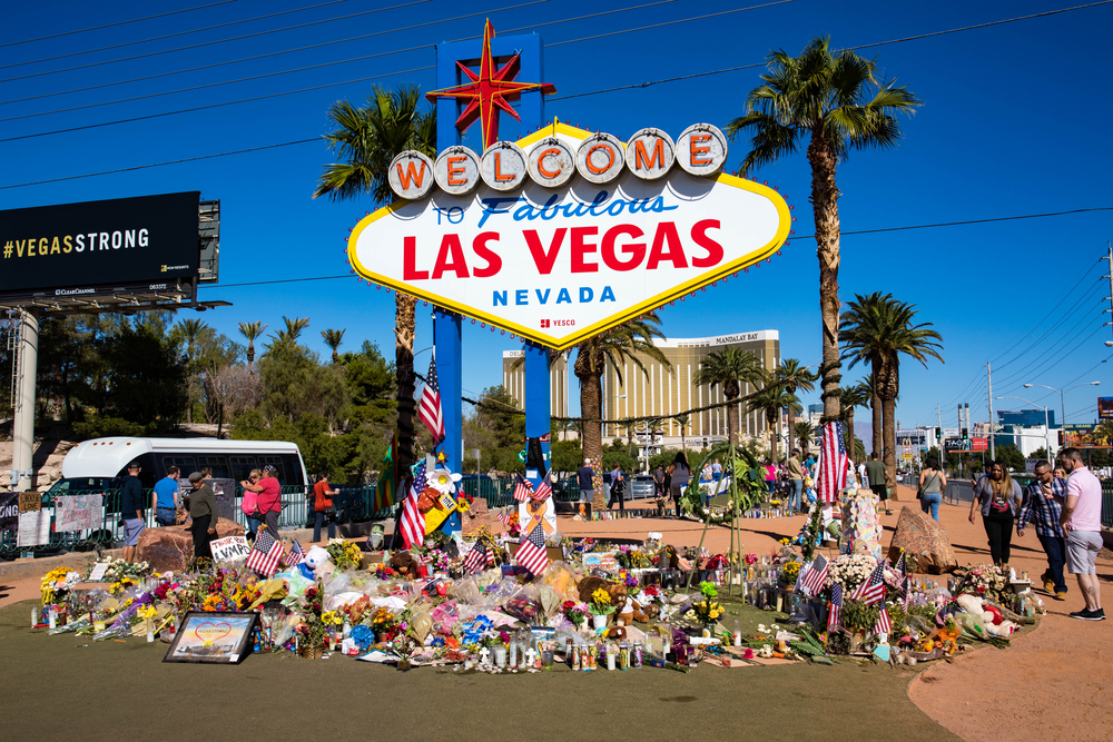 Las Vegas sign with flowers for victims of 2017 shooting