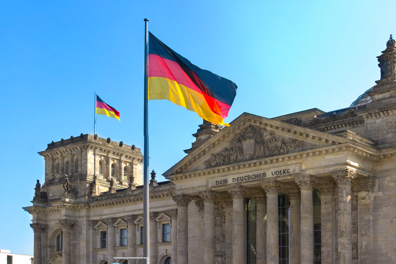 German flag flying outside of Parliament building