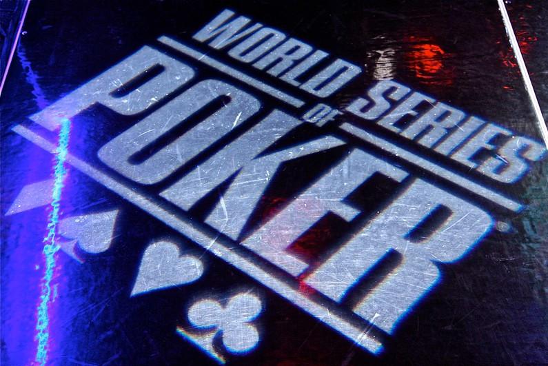 WSOP logo shining on a black floor