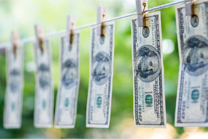 $100 bills on a clothesline