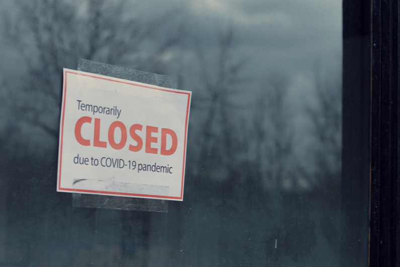 COVID-19 closed sign in window