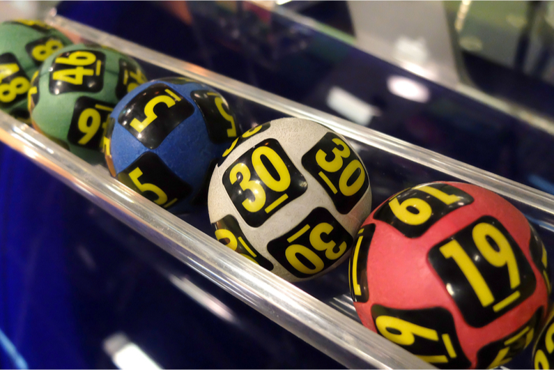 lottery balls in the chute after being selected