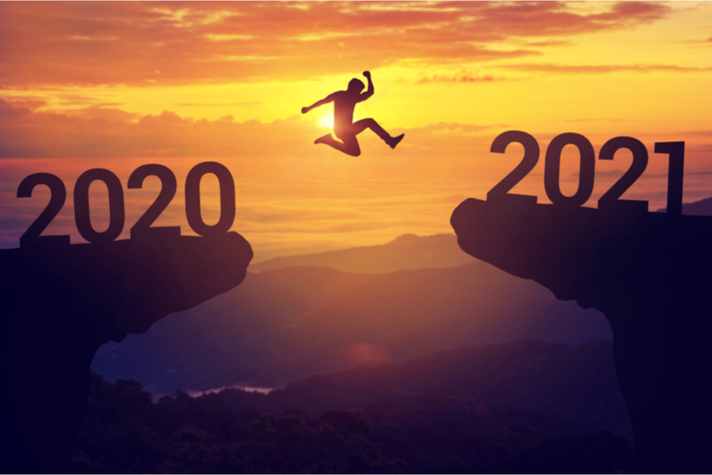 man jumping from 2020 to 2021
