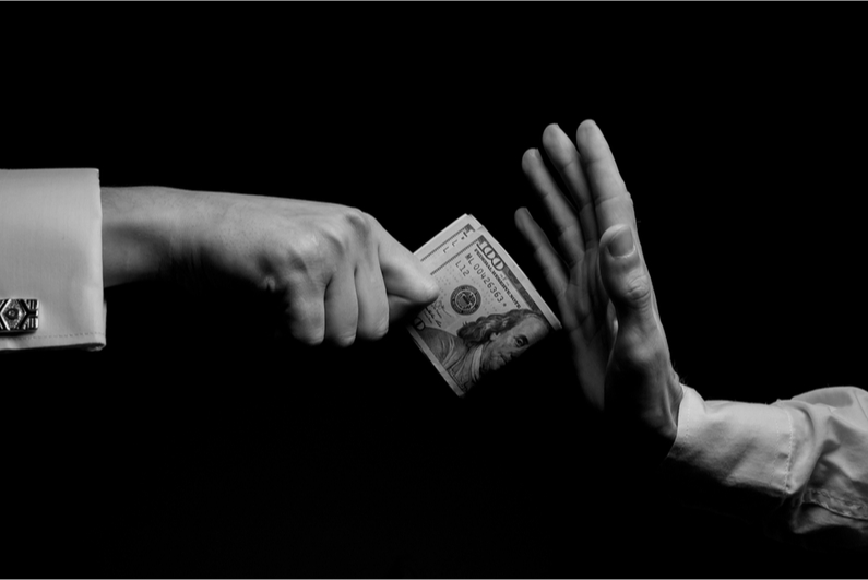 Closeup of person's hand rejecting money