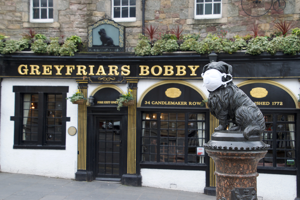 Greyfriars Bobby statue in Edinburgh protected with face mask during the COVID-19 pandemic