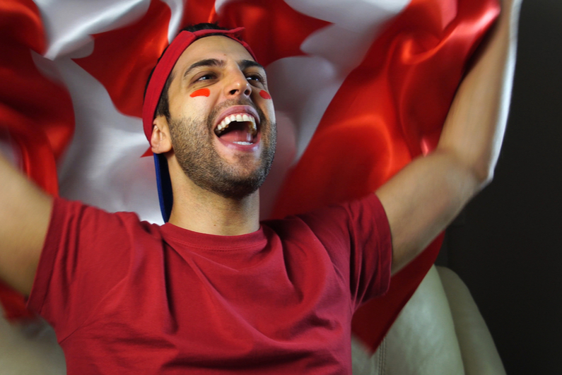 sports fan with Canadian flag