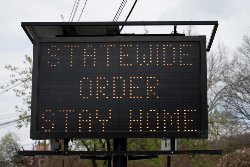 """Electronic road sign reading, """"Statewide order stay home"""""""