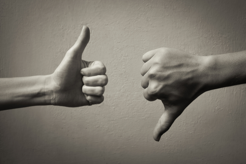 Hands giving a thumbs up and thumbs down