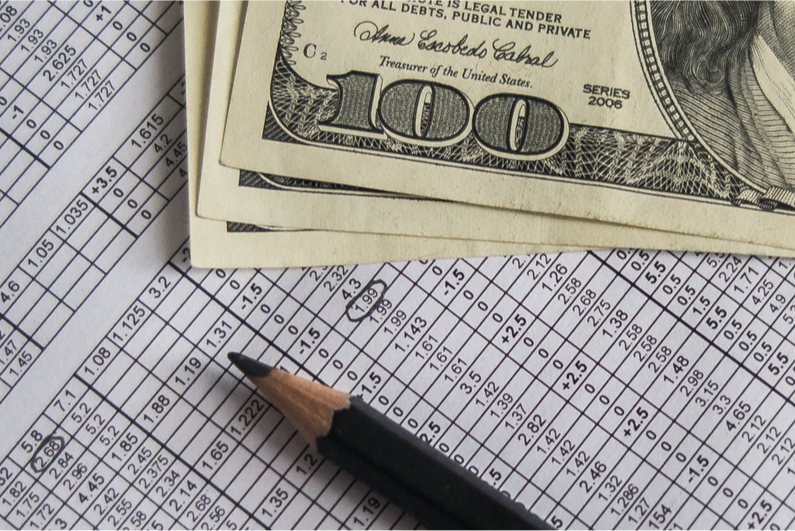 Cash on top of sports betting table