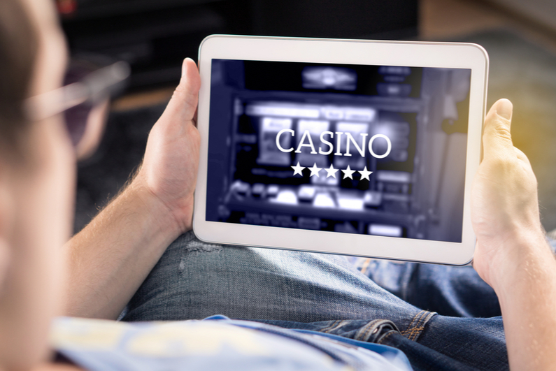 Man looking at casino gaming on a tablet