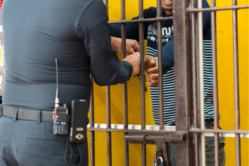 Thai police officer and prisoner in cell