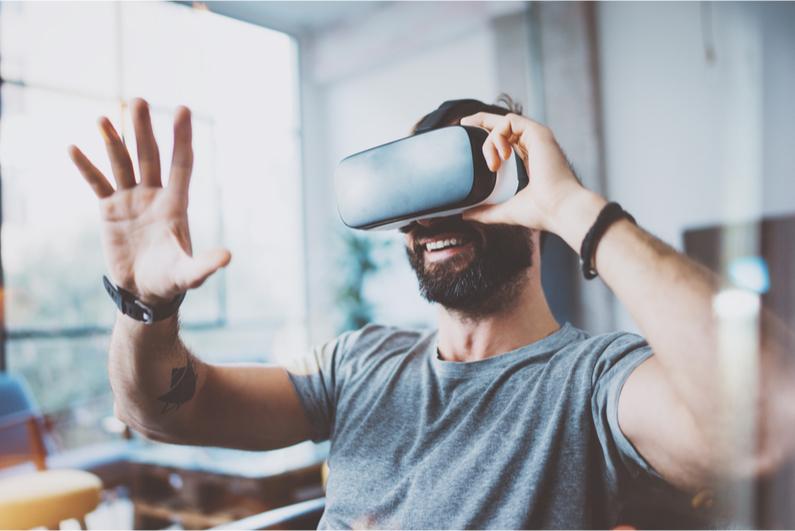 bearded man playing VR