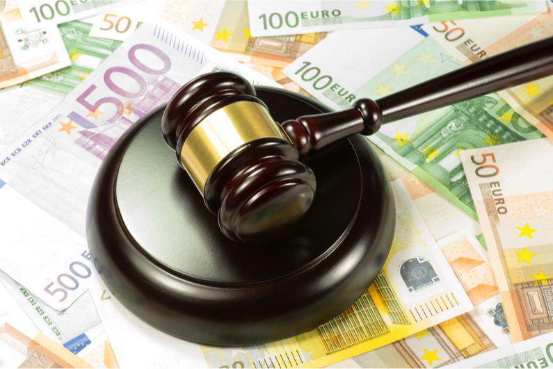 gavel on top of scattered Euro bills