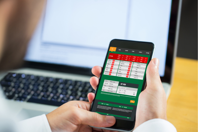 Businessman betting on a mobile phone