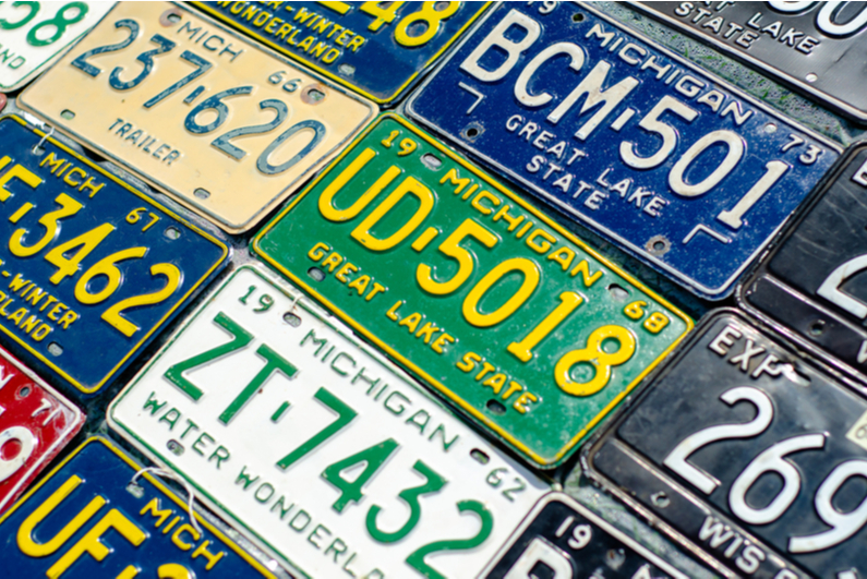 A variety of old Michigan license plates