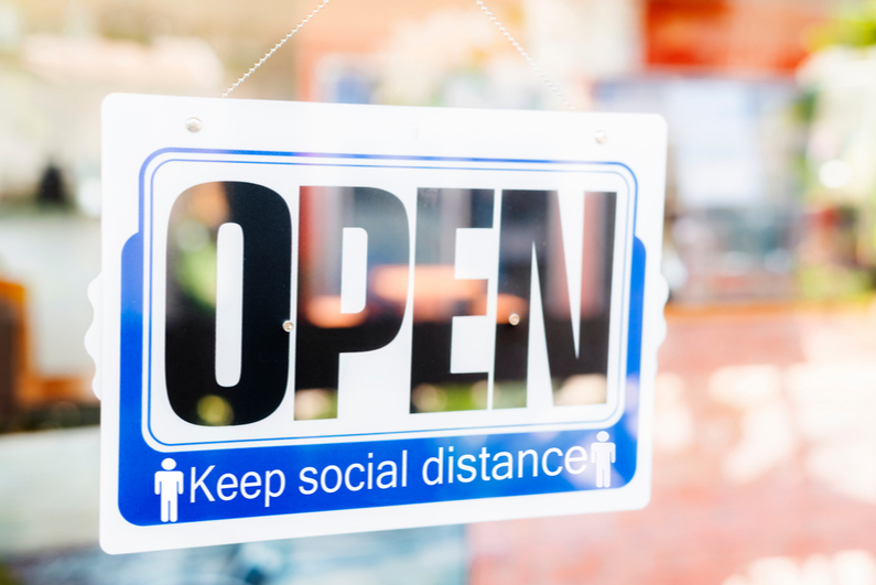 "Window sign reading ""OPEN Keep social distance"""