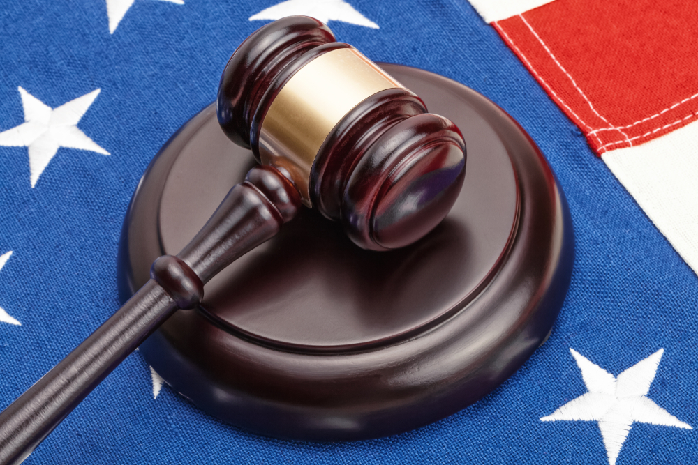 judge's gavel placed on US flag