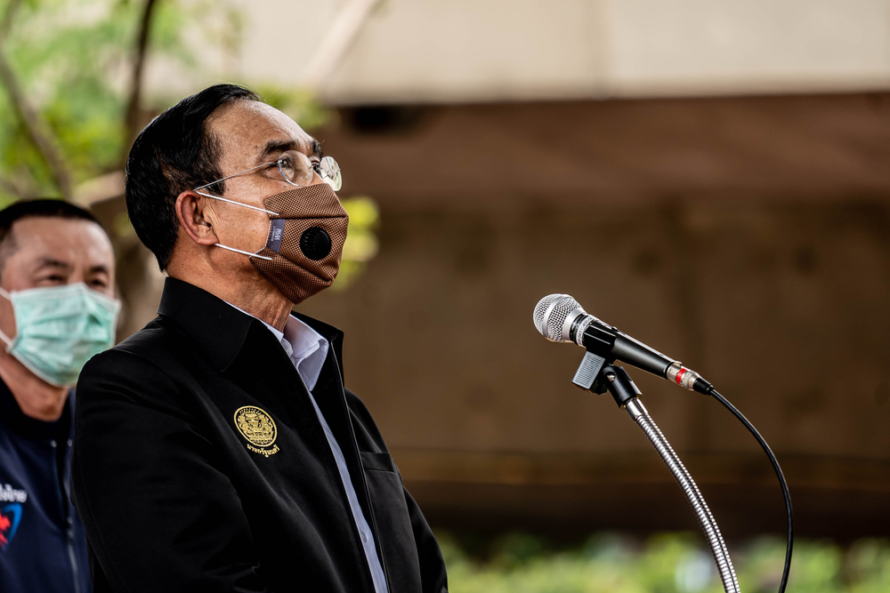 Thailand Prime Minister Prayut Chan-o-cha giving a speech in a face mask