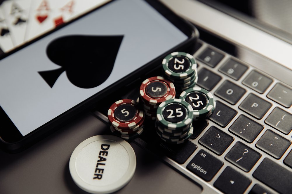 Ace card and only poker chips on laptop keyboard