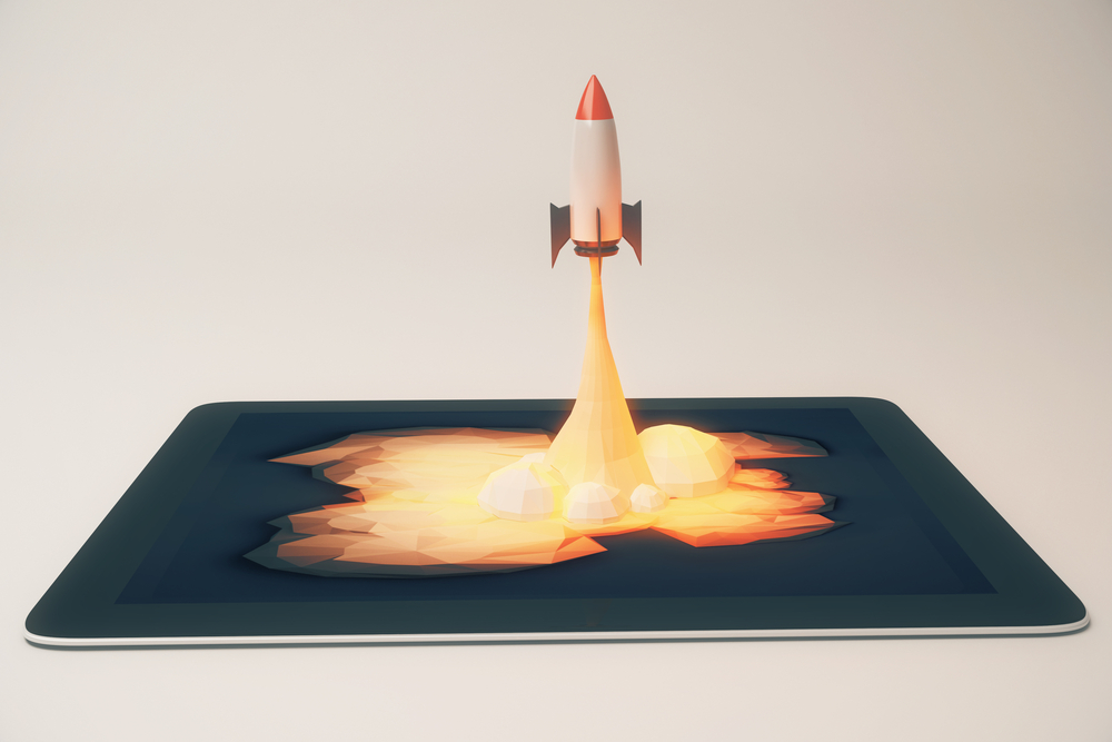online launch concept shows rocket launching out of tablet device