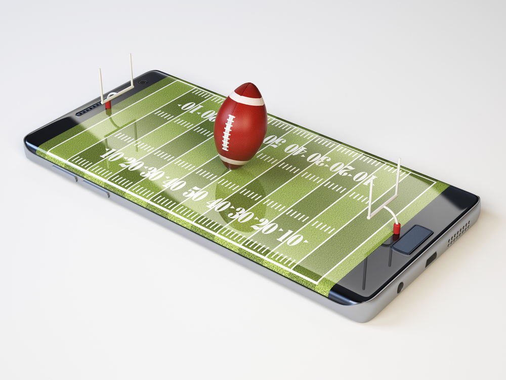 mobile sports betting concept shows American football and pitch images on smartphone screen