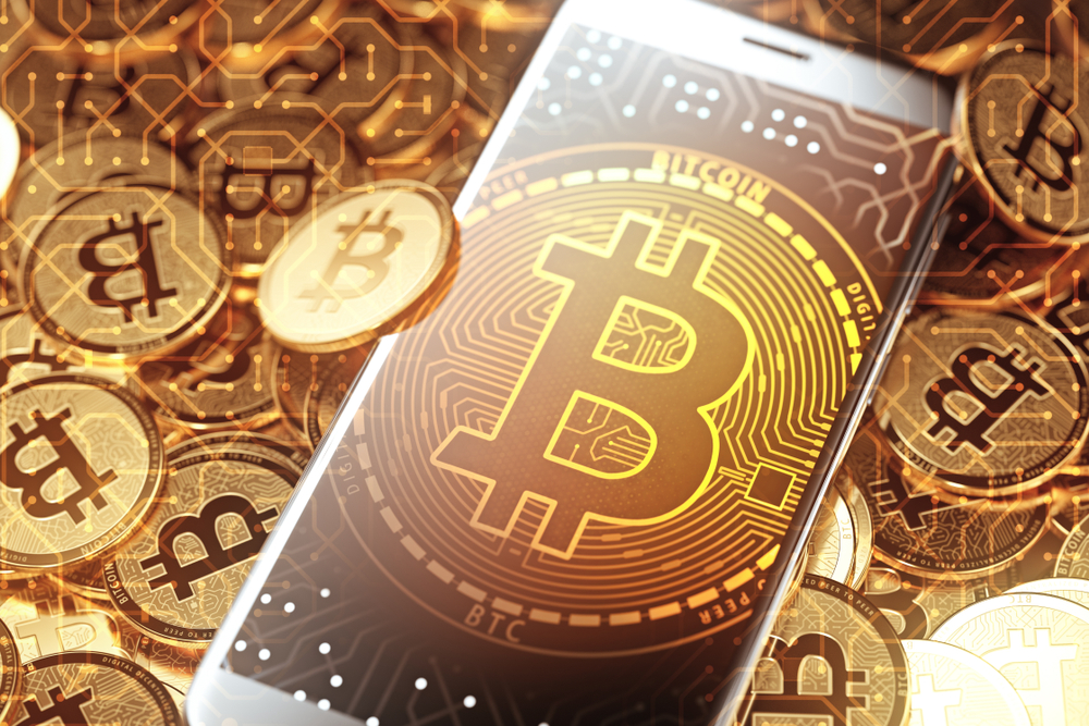 Bitcoin sign on smartphone surrounded by bitcoins