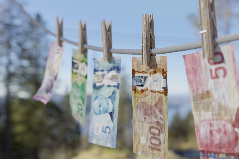 Canadian money drying on a clothesline