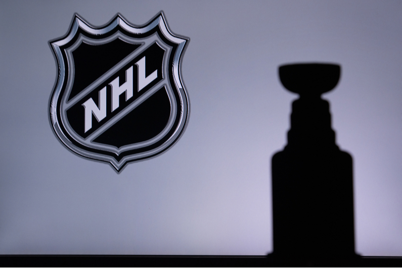 NHL logo with a shadow of the Stanley Cup in the background