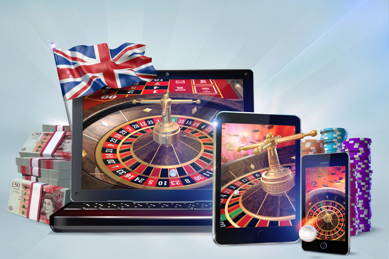UK online gambling concept - mobile devices showing a roulette wheel, flanked by the Union Jack