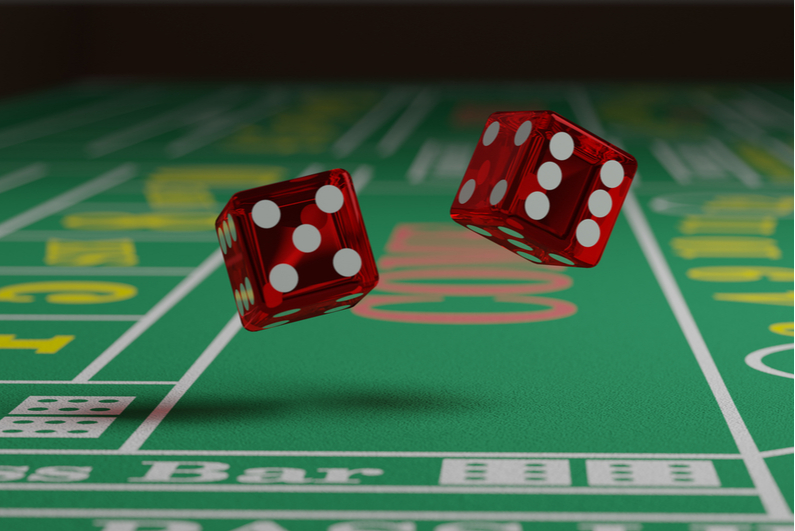 dice tumbling on craps table
