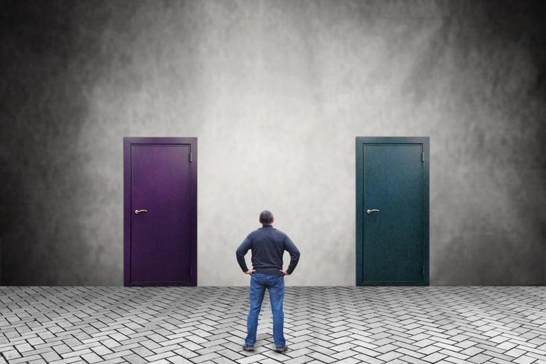 man deciding between two doors