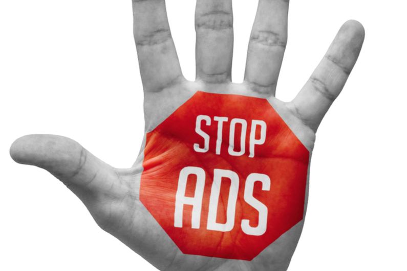 """""""stop ads"""" painted on a hand"""