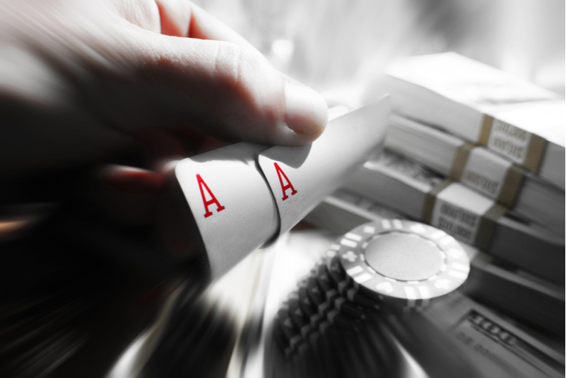 pocket Aces, chips, and cash in black and white