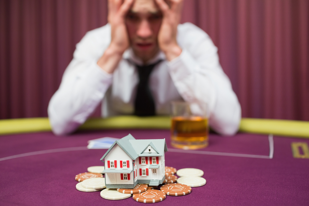 Man appears to be betting his house while playing poker at a casino