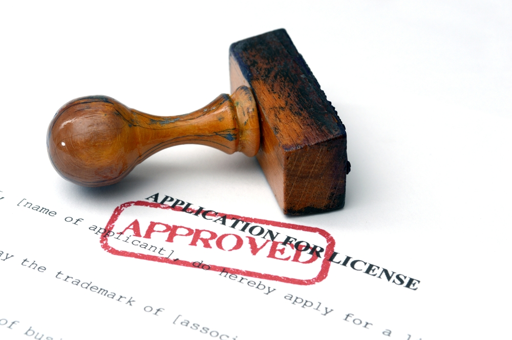 Red approval stamp on license application document