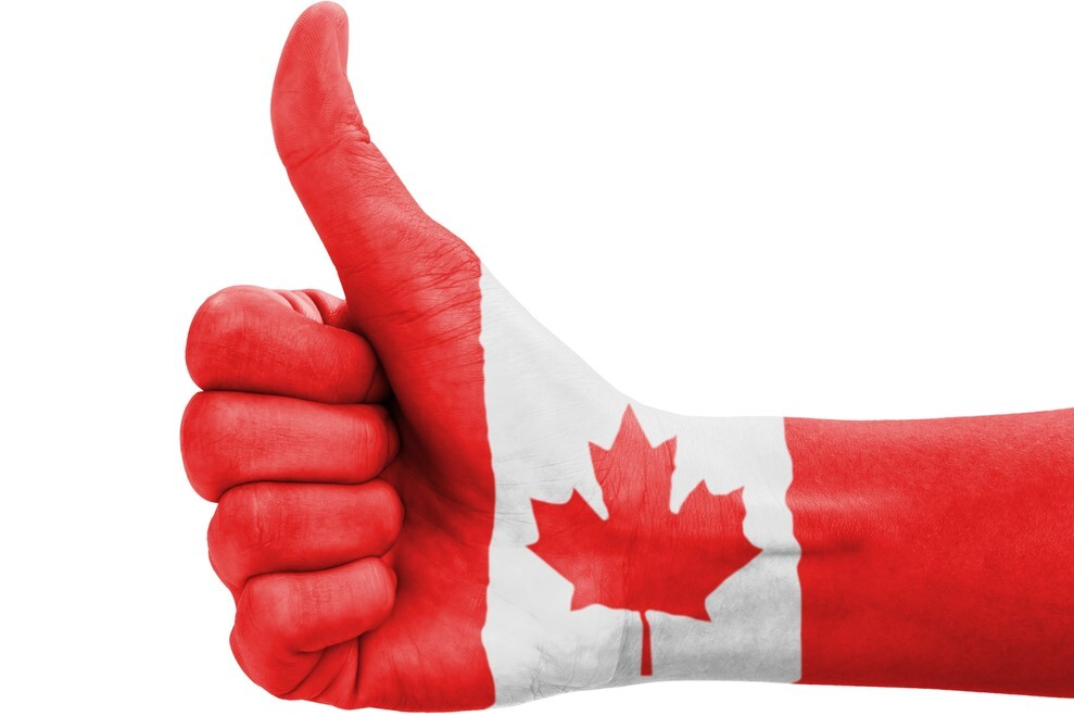 Hand giving thumbs up painted with Canada flag