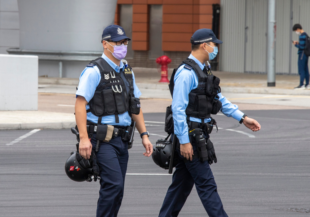 Two Hong Kong police officers wearing face masks