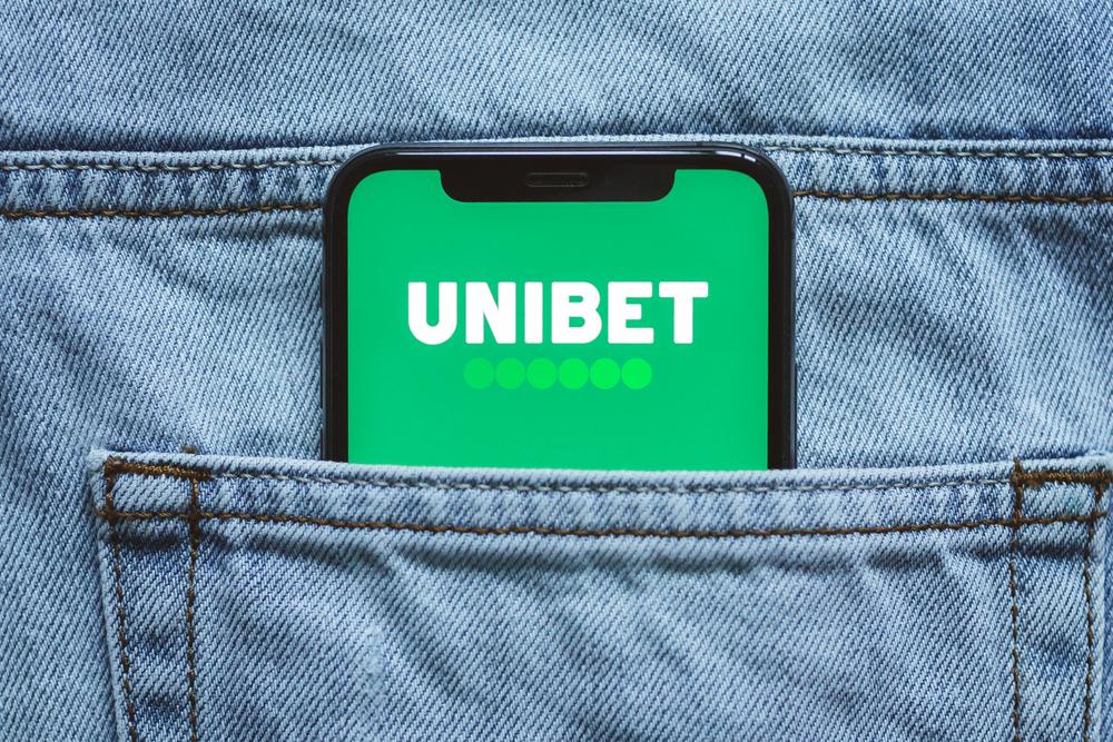 Unibet logo on phone screen in pocket