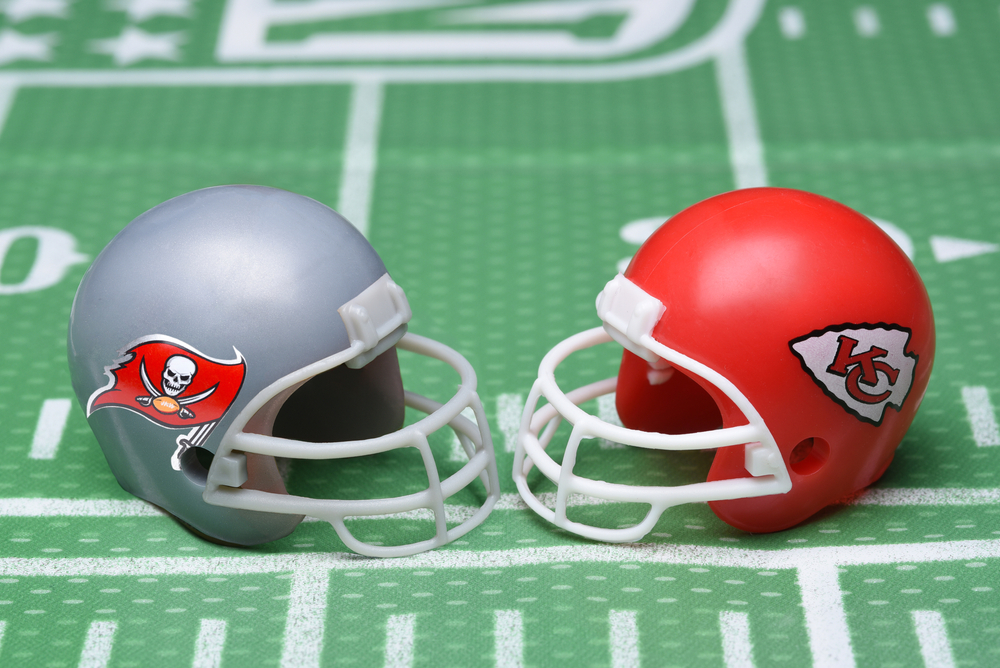 Tampa Bay Buccaneers and Kansas City Chiefs helmets on a pitch
