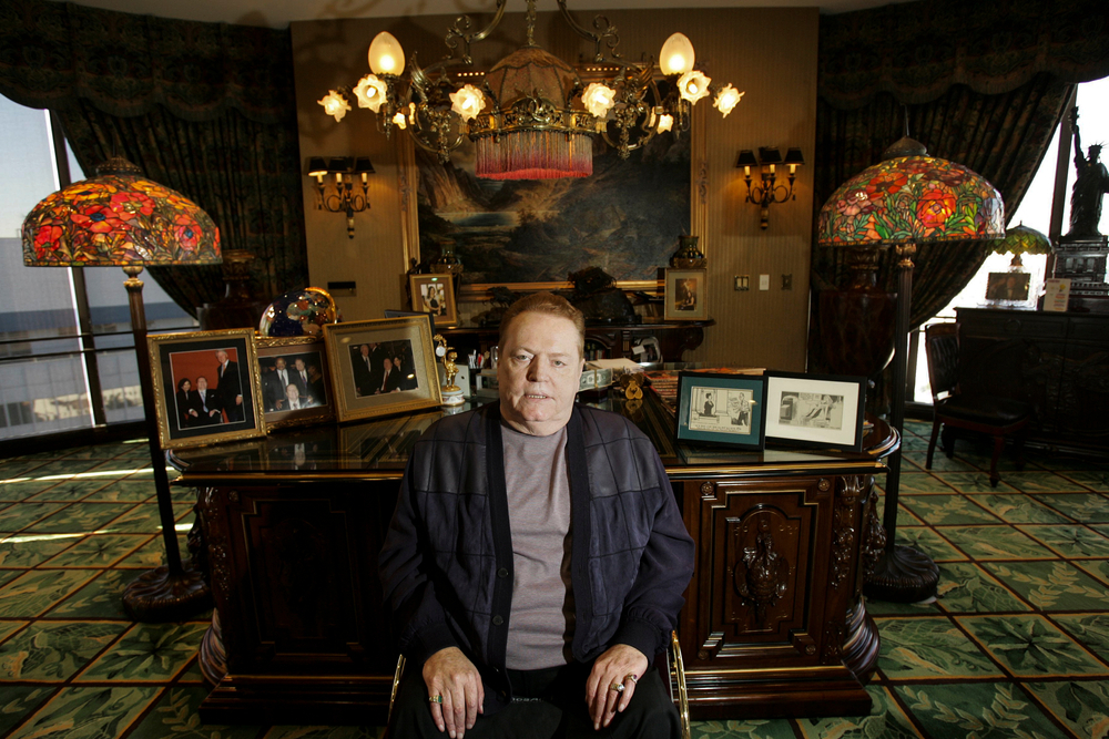 Larry Flynt sat in front of his desk