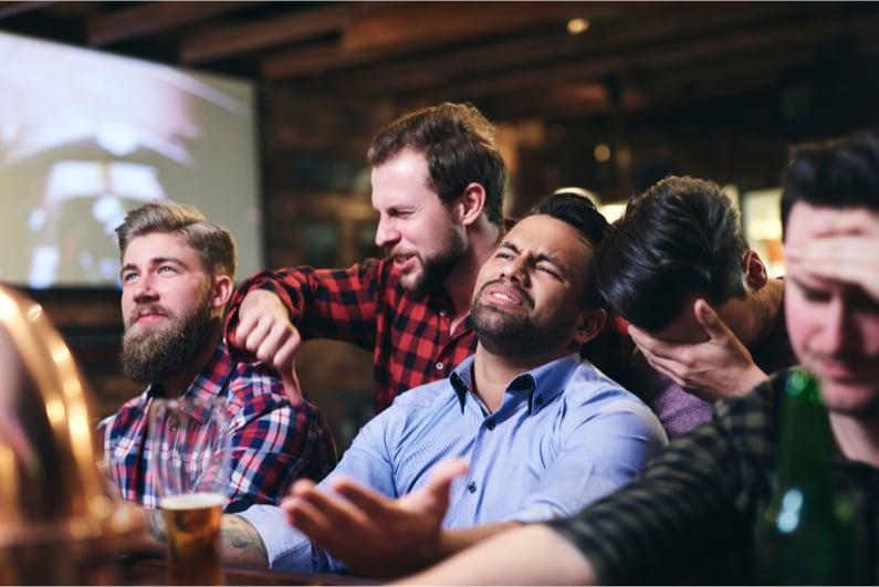upset sports fans at a sports bar