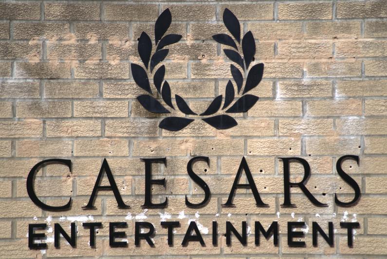 Caesars Entertainment logo on a brick building facade