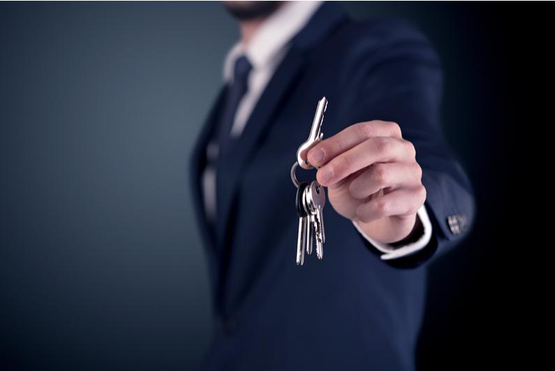 businessman handing over car keys