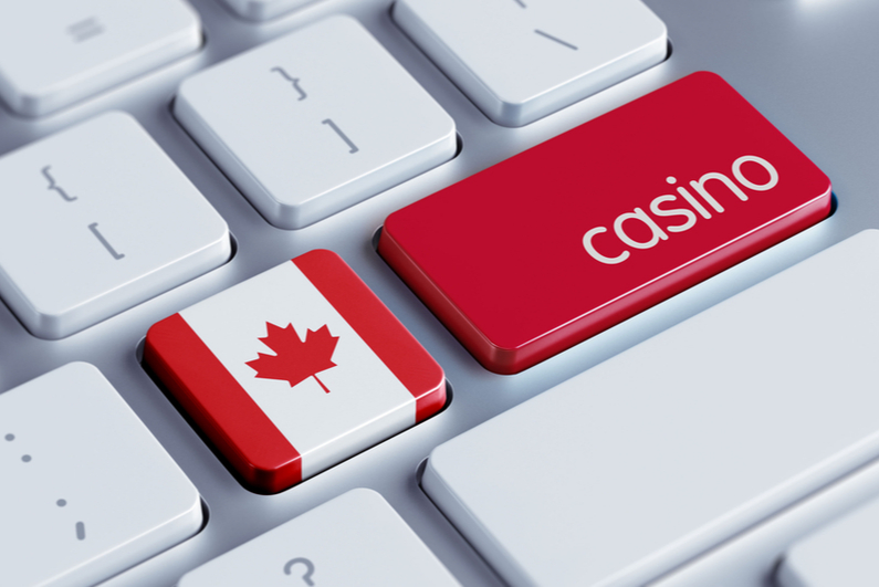 """Computer keyboard with a Canadian flag key and a red key reading """"casino"""""""